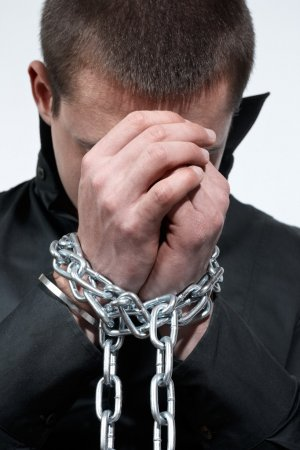 depositphotos_4628801-stock-photo-chained-hands